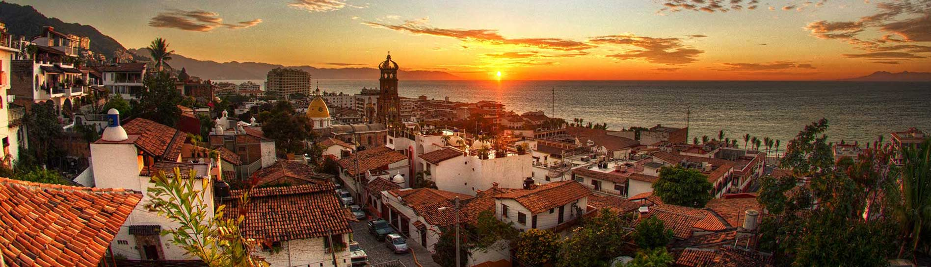 Sunset casts a red glow over Banderas Bay, Puerto Vallarta